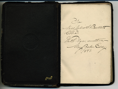 The copy of Miscellaneous Writings 1883-1896 inscribed by the author, Mary Baker Eddy, and given to her student Julia Bartlett. Longyear Museum collection