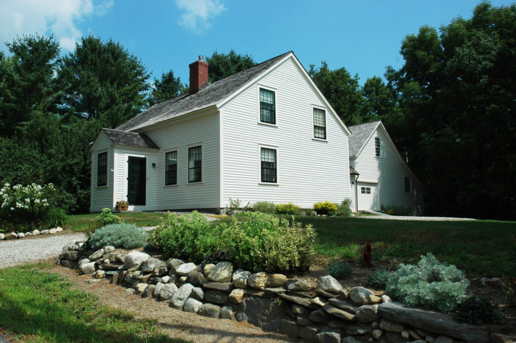 An exterior shot of Mrs. Eddy's home in Rumney, New Hampshire on a sunny day.